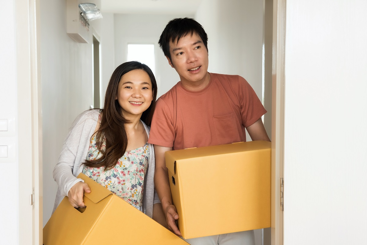 Couple carry box to move to new
