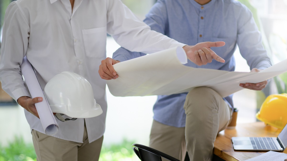Designers and builders view house plans to plan for construction